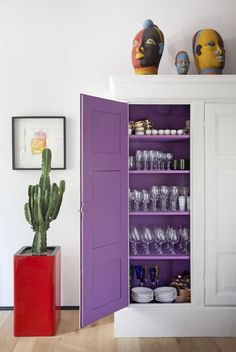 Italian Residence - Cabinet - This white cabinet holds a bright purple surprise.