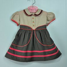 Beautiful vintage little girl's dress with cherries.