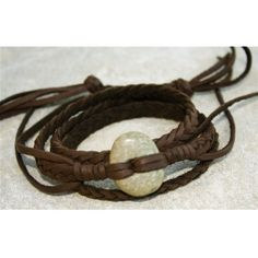 As seen on House of Jaguar  Ancient jade bead from Teotihuacan, Mexico. Early classic period (250 - 600 A.D.) Dark brown braided deerskin. Triple wrap bracelet. Length- adjustable.
