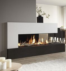 A real panoramic fire in your home: the DRU Metro gas fireplace. A real panoramic fire in your home: the DRU Metro gas fireplace. The DRU Metro gas fi 3 Sided Fireplace, Fireplace Feature Wall, Fireplace Windows, Living Room With Fireplace, Gas Fireplace, Contemporary Gas Fires, Contemporary Fireplace Designs, Fireplace Showroom, Fireplace Remodel