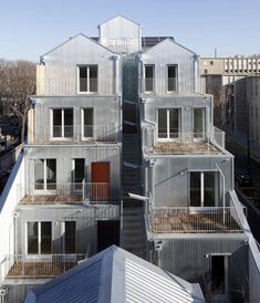 courtyard and exterior spaces hidden behind facade and central exterior stair