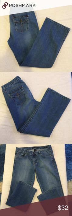 Calvin Klein Lean Boot Jeans Size 32/14 Calvin Klein Lean Boot Jeans. Size 32/14. In excellent used condition. 98% cotton, 2% Lycra/elastane. Measurements approximate. Waist 32 in. Inseam 29 1/2 in. Rise 10 in. 3 front pockets, 2 rear button closure flap pockets. Single button & zipper closure. Calvin Klein Jeans Jeans Boot Cut