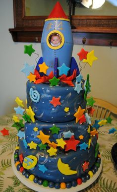 Space Boy outerspace/stars rocket ship first birthday cake from Cakes by Sarah Lake Worth. www.facebook.com/...