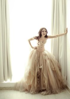 love the shape and the effect the tattered tulle gives.