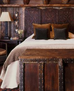 Beautiful rustic bedroom by Peace Design. Love the throw pillows and the headboard is to die for! wow. I want this!!!!