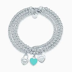 Return to Tiffany™ mini heart tags on sterling silver bead bracelets.