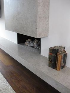 Queensgate polished concrete fireplace designed by Sigmar, UK