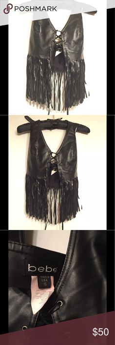 Vintage Bebe Biker Rocker fringe Halter Top black Never worn, purchased new by me circa late 1990s to 2000. Tag is XS, and this is super rad. Not in a hurry to sell it, so price firm-ish. This is a stretchy PVC PU Vinyl which can be laced or loosened to accommodate your needs. Chest is about 15 across unstretched. Waist is about 26 when measured slightly unlaced. Front length from cleavage to end of fringe is 14.5, in back 12.5. Best for for smaller small, XS. Not from an irritant free home…