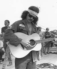"""""""Country"""" Joe McDonald took the stage at Woodstock on Saturday afternoon, August 16, 1969. It's a solo act. He'll be back Sunday night performing with The Fish. #Musicof1969"""