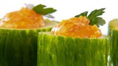 A yummy vegetarian appetizer for your holiday entertaining! Roasted red pepper hummus in cucumber cups