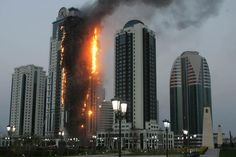 Chechnya High Rise Burns For 29 Hours With No Collapse, WTC7?