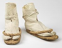 In Japan, the groom wore simple zori sandals with white socks called tabis. The socks are split at the toe so they fit through the thong of the zori.