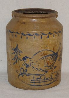 """Stoneware Jar. Marked H On Top Of Jar With Blue  Painted Chicken On Side. Slight Chipping to In  Side Of Rim But No Major Damage. Measures 8 1/2""""  Tall 6 1/2"""" In Diameter. $600"""