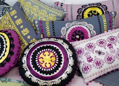 The hand embroidered cushions from Niki Jones are beautifully detailed. I love the colour palette too!