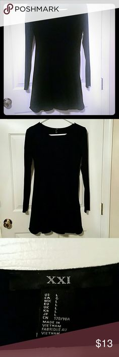Black baby doll dress. Simple and cute black dress with long sleeves, a flared skirt skirt. Would look cute alone or over leggings or tights.  Great condition. Forever 21 Dresses Long Sleeve