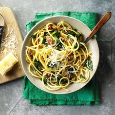 Bucatini with Sausage & Kale Recipe -I was short on time, but wanted to make an elegant dinner for my husband and me. That night, we ate this simple pasta starring spicy sausage and our homegrown kale. —Angela Lemoine, Howell, New Jersery