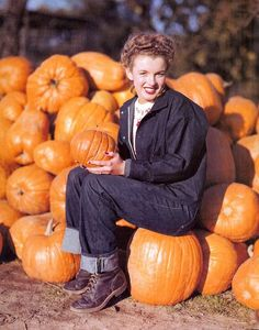 epic:  Norma Jean Baker (or Marilyn Monroe as she was later  known) sits on pumpkins in selvage jeans, chukka boots, and a demin  jacket in ...