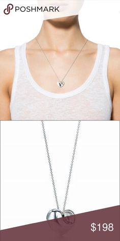 Tiffany & Co. Folded Heart Pendant Necklace -excellent preowned condition -purchased at Tiffany and Company at Scottsdale fashion Square mall -16 in. Sterling silver chain, sterling heart pendant Bundle up; offers always welcome! Tiffany & Co. Jewelry Necklaces