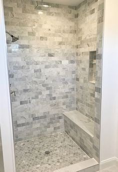 Large gray and white marble subway tile on shower wall and baseboard ...