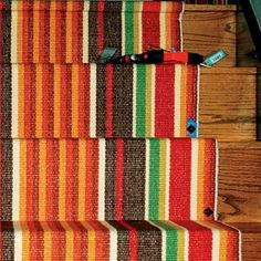 Put in a low-cost stair runner | 5 Low-Cost, High-Impact DIY Ways To Transform YourHome