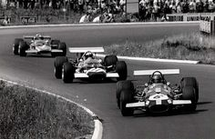 Jacky Ickx (Brabham BT26A #6), Jo Siffert and Jochen Rindt (Lotus 49B #11/#2) German Grand Prix 1969