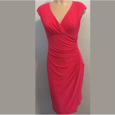 """Ralph Lauren size 4 Red Dress New with tags Ralph Laure size 4 Dress Red. Pull on, no zipper. Faux Wrap. Bust 16"""" side to side Waist 13"""" side to side Hips 16"""" side to side Length 38"""" shoulder to hem. Measurements are approximate. Lauren Ralph Lauren Dresses"""
