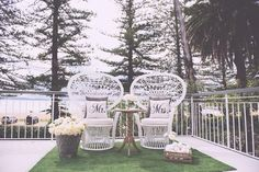 Gorgeous vintage white wicker peacock chairs! | Sarah and Jimmy's Elegant Palm Beach Wedding