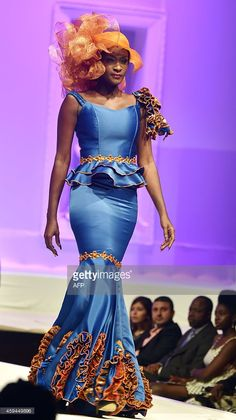 A model takes part in the 9th 'Afrik Fashion' in Abidjan on November 22, 2014. Designers from Benin, Burkina Faso, Niger,Togo, Senegal and Ivory Coast attended at the African fashion trade show and presented their latest creations. AFP PHOTO / ISSOUF SANOGO