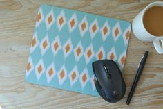 Ikat Print Mouse Pad, Modern Print Mouse Pad - Modern Home Decor - mousepad - teal ikat, orange ikat, blue ikat - office accessories, ikat by yourethatgirldesigns on Etsy https://www.etsy.com/listing/127048219/ikat-print-mouse-pad-modern-print-mouse