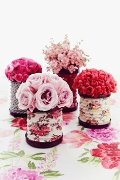 Floral Tablecentres -   Up the floral count by filling accordion-style patterned lanterns with flowers. Support the inside of a lantern with card. Fill a jar with water and place inside. Trip the flower stems and arrange as a dome