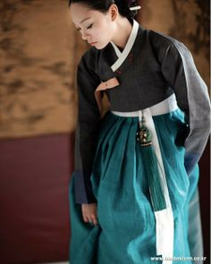 Stunning black hanbok that explicitly demonstrates restrained beauty and style. With teal color skirt and norigae (charm that goes with skirt), it is even more stylish! - Hanbok is a Korean. Korean Traditional Dress, Traditional Fashion, Traditional Dresses, Korean Dress, Korean Outfits, Modern Hanbok, Culture Clothing, Japanese Kimono, Asian Style