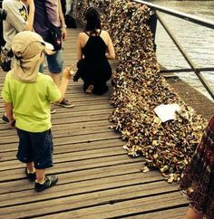 """""""Part of Paris bridge collapses under weight of 'love locks' left by tourists - Is there such a thing as too much love?"""" -- A five-foot long section of metal mesh fell inwards onto the Pont des Arts footbridge on June 8, 2014, under the weight of the hundreds of thousands of """"love-locks"""" attached to the bridge by couples. (Photo: Twitter/Eric Andre)"""