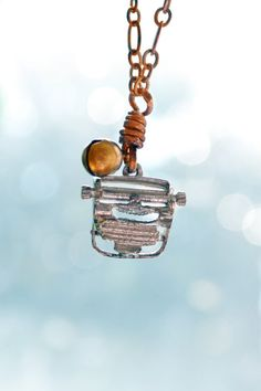 A vintage sterling silver typewriter charm with moving paper-feed roller? Woa.    This rare gem dangles lightly aside a tiny Thai brass bell secured with an oxidized copper wire. A vintage solid copper chain also adds a natural healing energy. This modest statement is the perfect addition to any human. For him or her! <3  by We Are Creatures