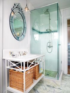 Bathroom with glass shower white walls large mirror counter with basket drawers