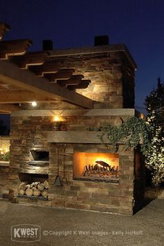 Outdoor Pizza Oven Fireplace Combination | Stone Fireplace / Pizza Oven & Night Lighting modern landscape