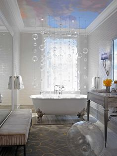 The cascade of bubbles floating in mid-air were so delicate. This detail made the room stand still and brought a sense of calm and clean to this dreamy bathroom. By COFFINIER KU DESIGN.