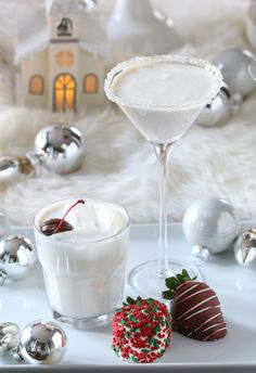 White Christmas Martini Cocktail Recipe. 2 parts Vanilla Vodka - 2 parts White Chocolate Liqueur - 1 part White Creme de Cacao - 1 part half-and-half - Honey and coarse sanding sugar for rim garnish.