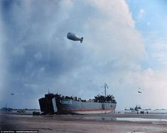 USS unloads on a Normandy beach at low tide, 12 June (Note barrage balloon overhead, as an obstacle to low-flying enemy aircraft.) Class Tank Landing Ship: - Length mts) o. D Day Normandy, Normandy Beach, Colorized Photos, Ww2 Photos, Photographs, History Photos, History Facts, Photo Timeline, D Day Landings
