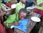""" Krass e.V. In der Nähe der Stadt Akosombo am Voltasee, in dem kleinen Dorf Aglova malte ich mit Kindern und Jugendlichen, erzählt Arno Lindenberg, der Kopf von KRASS vor Ort in Rösrath""""."""
