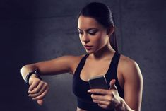 woman with heart-rate watch and smartphone in gym by dolgachov. sport, fitness, technology and people concept – young woman with heart-rate watch and smartphone in gym Gym Photos, Sports Photos, Fitness Trackers For Women, Before Bed Workout, Best Fitness Tracker, Fitness Tips, Health Fitness, Workout Schedule, Monthly Workouts