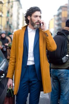 a pop of color // topcoat, menswear, suit, european style, solid colors, mustard, blue suit, no tie