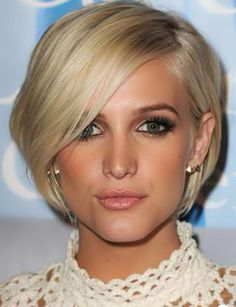 Fine short blonde lengths which gracefully frame the face and lacing the nape.
