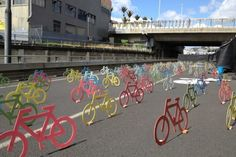 On an overpass and unused off ramp in Auckland, hundreds of bikes in various sizes and colors were set up as part of a large-scale art installation.