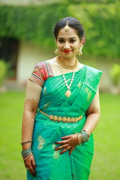 green silksaree with red blouse