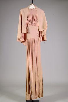 Elsa Schiaparelli evening dress of pink silk, circa 1938-1939.