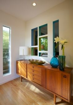 Love the credenza, but don't overlook the wall cutouts with bold colors painted on the inside!