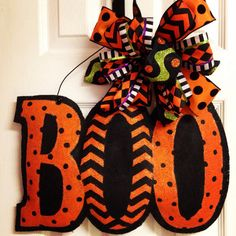 This is a cute Halloween stuffed burlap door hanger. It has been hand painted in polka dots, chevron print, and a little dash of glitter; Burlap Halloween, Cute Halloween, Halloween Crafts, Halloween Decorations, Halloween Wreaths, Halloween Signs, Halloween 2019, Holiday Wreaths, Halloween Door Hangers