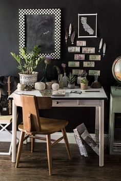"""This little desk area is situated in my mud room. The desk and chair are vintage and handed down from my sweet grandmother. I like to create little vignettes throughout my home to showcase my most treasured items. And all the foreign currency was from my travels and when my airbnb guests noticed I had taped it to the walls, they started to add to it from their home countries as well."""