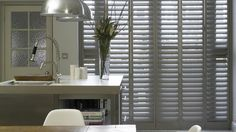 Think shutters are just for windows? Dress up any of your french and patio doors with a set of our expertly crafted and installed door shutters. Living Room Blinds, Bedroom Blinds, House Blinds, Vertical Window Blinds, Blinds For Windows, Bay Window Curtains, Diy Curtains, Wooden Shutters, Wooden Doors
