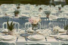 rose and rosemary centrepiece on long imperial table on the grass!